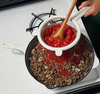Press the tomatoes through a sieve and discard the seeds.