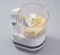 Combine pasta mixture in the food processor and run until the dough forms a ball.