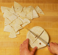Cut tortillas into chips when making corn tortilla chips to go with Mexican cooking recipes.