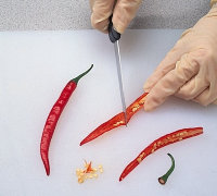 Use rubber gloves when cutting chili peppers when cooking Mexican food.