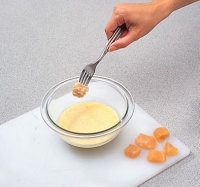 Use a fork to dip small chicken chunks or strips into batter.