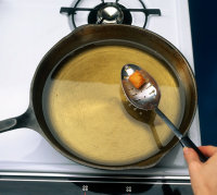 Use a heavy saucepan to heat the oil to avoid burning.