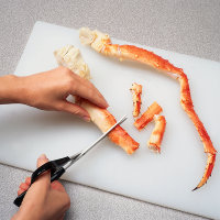 Using poultry shears or a cleaver, cut the crab legs into 2-inch pieces.