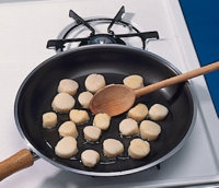 Make sure the oil is well heated before you add the scallops.