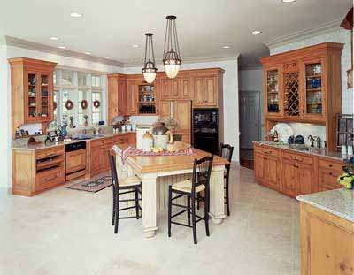 Elegant yet casual, this French country kitchen utilizes angled walls and a kitchen island for a dramatic look.