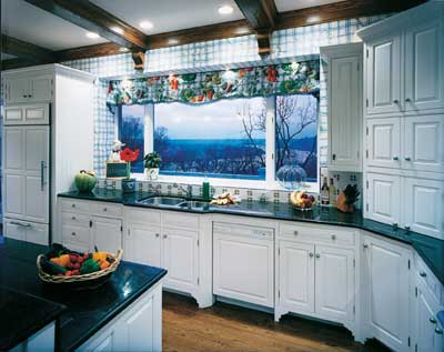 This winding countertop can run along the length of this long wall and contain the sink and a range.