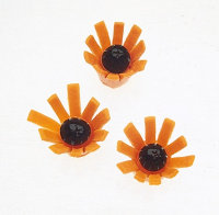 Garnish with Carrot Daisies.