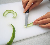 Scrape peel to remove membrane, if needed, when garnishing.