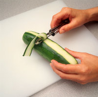 Cut thin strips from cucumber, leaving a line of green peel.