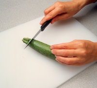 Cut off ends of zucchini with paring knife.