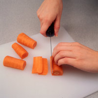 Cut a strip so carrot can lie flat when making matchstick carrots.