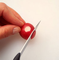 Cut a thin slice from the radish when making radish rose garnishes.