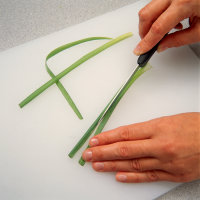 Cut tops lengthwise with a paring knife.