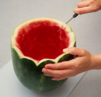 Cut along pencil lines to make a watermelon basket garnish.