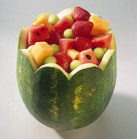 Garnish watermelon bowl.