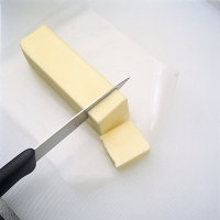 Cut butter into 1/2-inch pieces.
