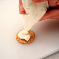 Gently squeeze bag to create cream cheese puff.