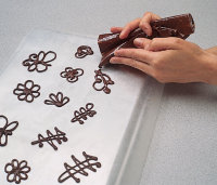 Squeeze chocolate into desired shape.