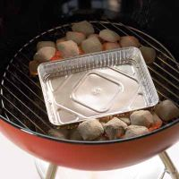 Place coals to the side for indirect cooking while grilling.