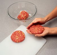 To grill lamb burgers, shape patties on a cutting board so you can easily carry them right to the grill.