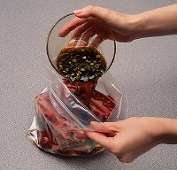 Marinate short ribs in a plastic resealable food storage bag for convenience and easy clean up.