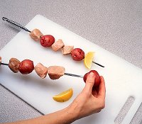 When grilling pork kabobs, don't put too much food on one skewer.