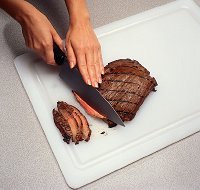 Use tongs to turn the steak. Piercing with a fork will release the juices.