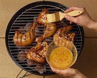When grilling chicken quarters, brushing chicken frequently with a flavorful sauce is a great way to add flavor.