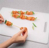 When grilling chicken skewered strips, thread the green onion pieces crosswise on the skewers.