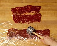 When grilling beef, flatten skirt steaks to tenderize and assure even cooking.