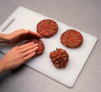 When grilling hamburgers and grilling cheeseburgers,  keep your burgers relatively thin so they cook evenly and quickly.