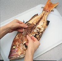 When grilling whole fish, pull the skin gently to remove it from the snapper.