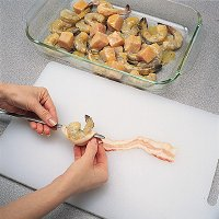When grilling swafood kabobs, handle the seafood and the bacon gently to prevent tearing.