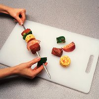 To grill steak kabobs, thread beef cubes on skewers with vegetables that will cook in the same time.