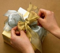 Tie silver and a gold bow around the package to echo the wrapping paper.