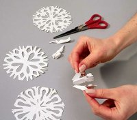 Experiment with various cuts to produce differently shaped snowflakes.