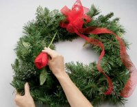If the wreath is viewed as a clock, glue a stem at 7 o'clock.