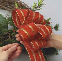 Use floral wire to secure the velvet ribbon to the wreath.