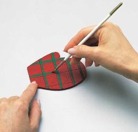 On the second coat, paint the two red mittens with a plaid design.
