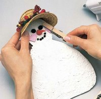 Wrap the back of the hat around the snowman's head so it fits snugly.