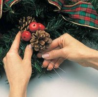 Bundle the pinecones and the berries together and attach them to the wreath.