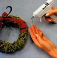 In step 2, glue the end of the folded wire to the top of the wreath.