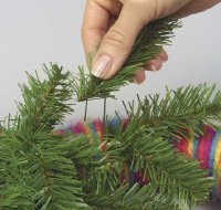 Insert sprigs of evergreen in an arc across the top of the wreath.