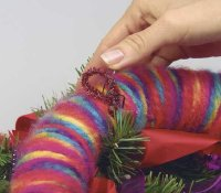 Use a chenille stem to hang the wreath.