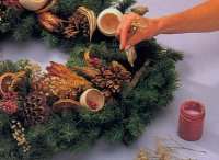 Glue in various stems onto the wreath.