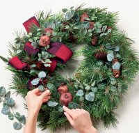 Cut the foliage into short lengths and glue in between the pinecones.