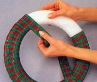 Wrap the ribbon around the foam wreath.