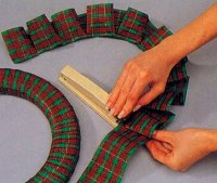Make box pleats out of the remaining Christmas ribbon.
