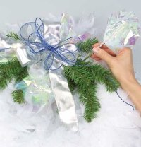 Attach the tissue paper to the floral pick and insert them into the wreath.