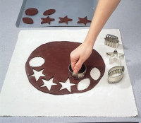 Use cookie cutters to cut the dough.